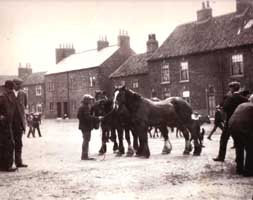 Old photo of horses and houses at Little Green